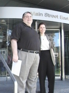 Gary & Christine McHale stand on steps of Hamilton courthouse April 21/10 after the Crown ended its 30-month prosecution of him for 'Counselling Mischief Not Committed.' The charge was dropped during the Preliminary Hearing after McHale convinced another court to issue charges of Obstructing Justice against 2 senior officers involved in his case: now-Commissioner Chris Lewis and Superintendent Ron Gentle.