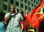 Canadian Arab Federation VP Ali Mallah stands beside Mohawk Warrior flag, Toronto anti-Israel protest, Aug 12/06