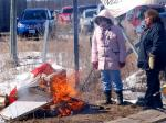 March 27/11, Douglas Creek Estates occupation site, Caledonia, Ontario, Canada: Police watch as native occupiers swarm, steal Apology/Reconciliation monument, smash and burn it along with Canadian flag.