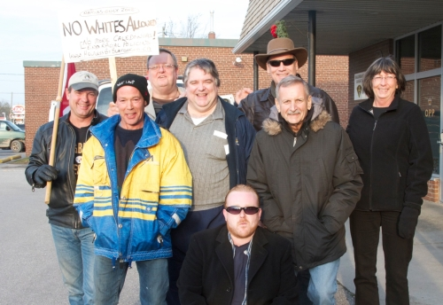 111203 Jeff Parkinson (kneeling) with the rest of the Caledonia 8 at OPP's Caledonia sub-station following arrests. PHOTO BY STUART LAUGHTON