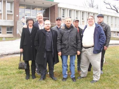 120203 The Caledonia Eight pose on the lawn of the Haldimand Admin building after trespassing charges dropped. L to R: Bonnie Stephens, Mark Vandermaas, Jeff Parkinson, Randy Fleming, Merlyn Kinrade, Doug Fleming, Gary McHale, Jack Van Halteren