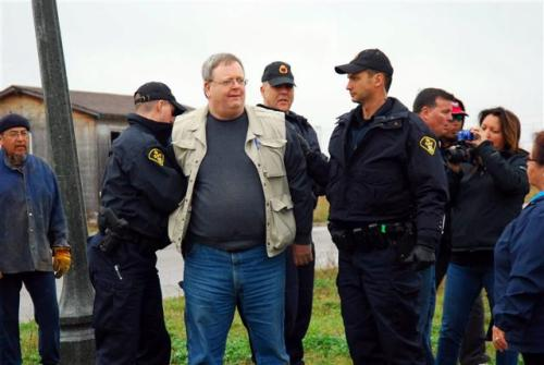 120421 Mark Vandermaas is arrested after being assaulted by Mohawk Warrior Ken Greene on Douglas Creek Estates 'no-go zone,' Caledonia, Ontario, Canada. PHOTO BY CHRISTINE MCHALE
